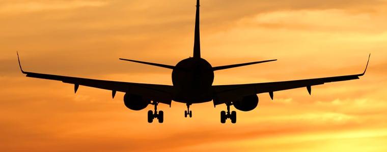airplane on orange sky