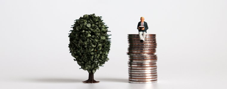 miniature man on stack of coins