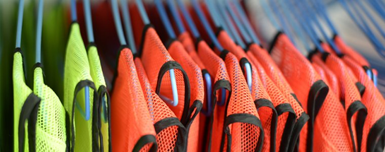 orange and yellow safety vests