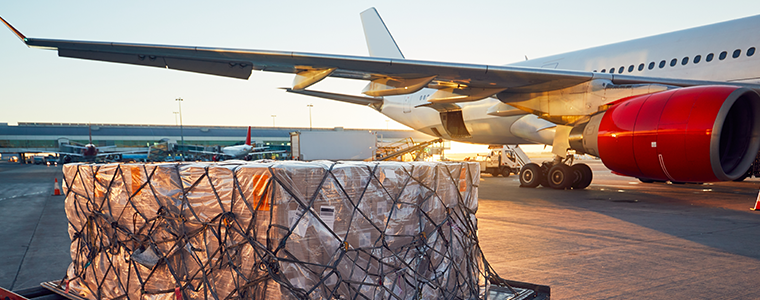 Shipment on pallet being prepared to load on airplane